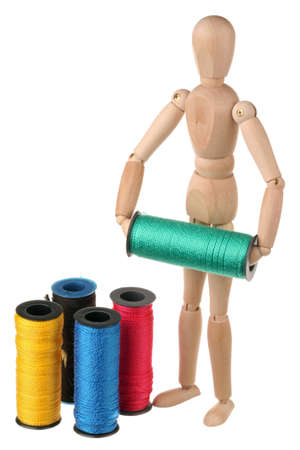 Mannequin and colored thread on white background photo