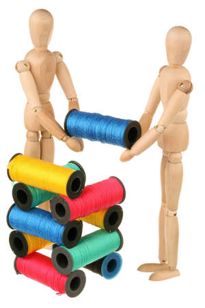 Two dummy stack bobbins with color threads isolated on white background photo