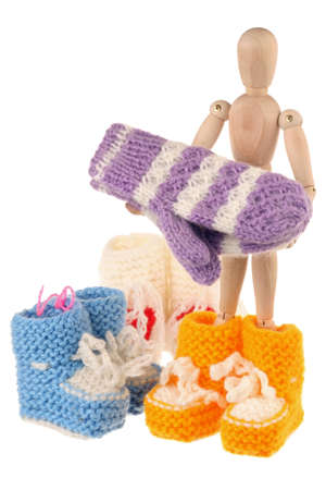 Baby wool socks and mannequin isolated on white background photo