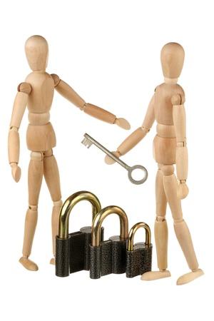 Dummies, locks and key isolated on white background photo