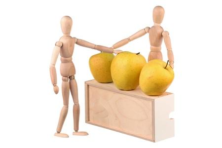 Dummy chooses a large yellow apple isolated on white background Stock Photo - 12869578