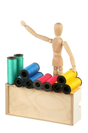 Dummy - seller of colored thread isolated on white background  photo