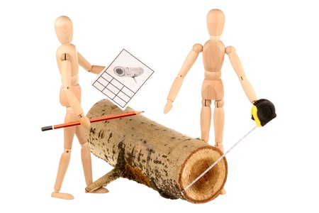 Dummies measure the diameter of a log isolated on a white background  photo
