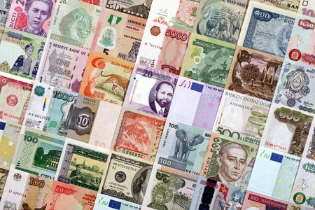 staggered: Paper money of different countries are staggered