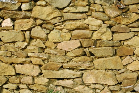 Stonework - a fragment of a stone wall in the Caucasian village photo