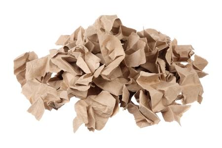 waste paper: Pila de papel usado aislada en el fondo blanco