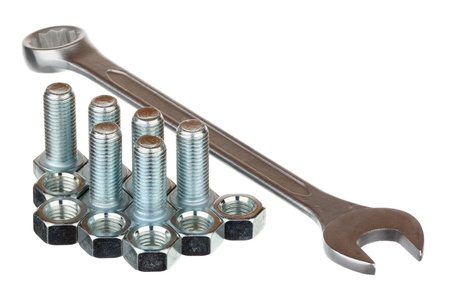 Screw bolts, nuts and spanner isolated over white background  photo
