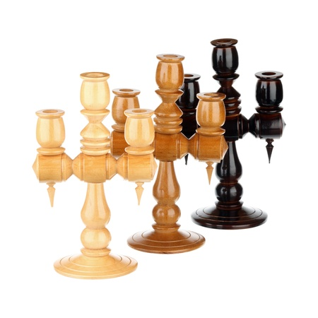 Three wooden candlesticks over white background Stock Photo - 19060937