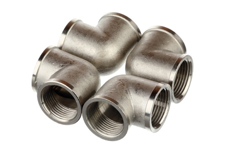 Four metallic fittings isolated over white background