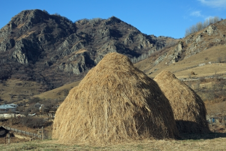 Two haystacks in the mountains
