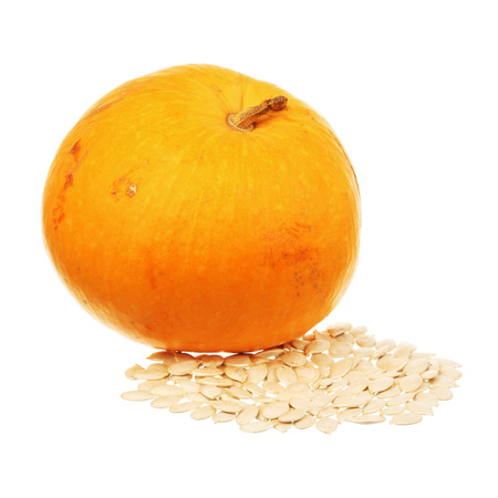 Pumpkin and seeds isolated over white background