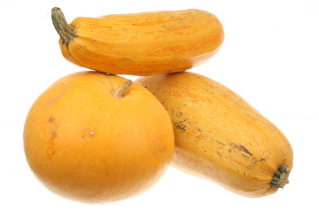 Pumpkin and two zucchini isolated over white background