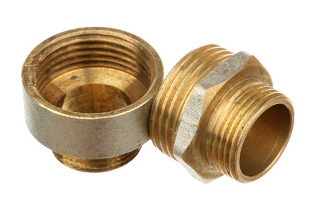 Two brass fittings isolated on a white background Stock Photo