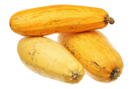 Three yellow zucchini isolated on a white background