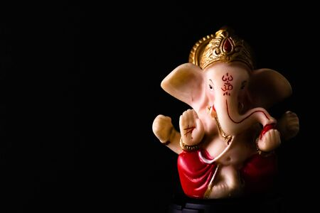 side view close up of ganesha statue on the black background with copy space. hinduism concept Stock Photo