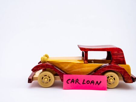 A minimalist close up shot of one vintage car toy against white background for loan concept Banco de Imagens