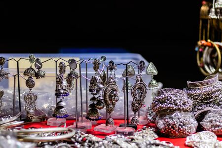 High angle close up shot of beautiful silver jewellery sold in the road side shops