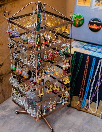 High angle shot of beautiful and ethnic jewellery on display outside a local street shop