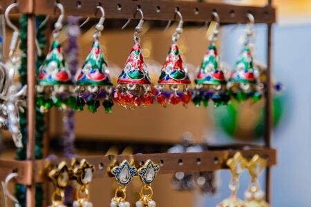 Close up of beautiful stone and metal jewellery ethnic style with blurred background Imagens