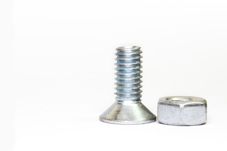 bolt and nut on white background, abstract photo