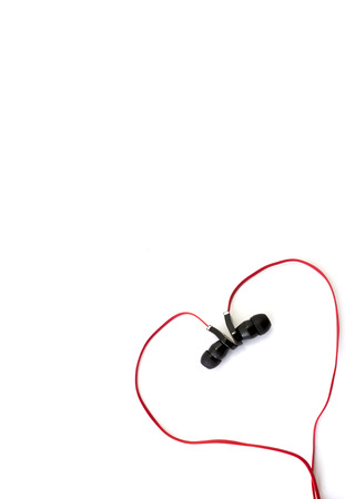 caption: red earphone setting in heart shape and spacing for caption