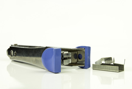 Staples and Stapler on white background, isolated photo