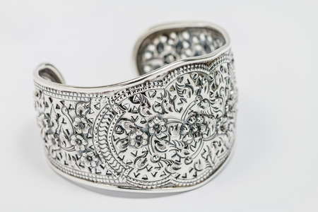 bangle: Old silver Bangle, floral pattern, on white background.