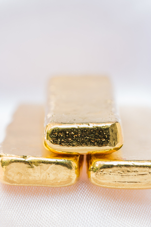 shiny gold: Gold ingot textures - background with space for text. Macro.
