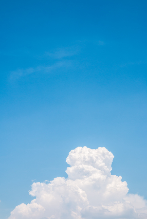 sunlight sky: White clouds under blue sky in sunny day, use for  background. Vertical image.