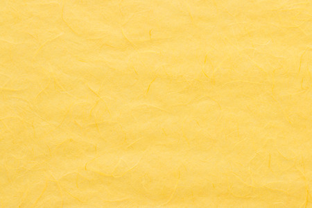 yellow paper: Yellow mulberry paper texture, suitable for a background.