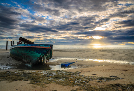 beached: The fisherman ship has been abandoned after damaged by storm Stock Photo