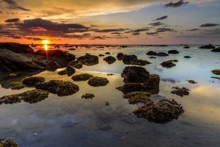 seascapes: The golden hour sunset. The coral live fertile during low tide sea water
