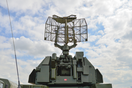 defense facilities: antenna military radar on the background of blue sky Stock Photo