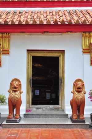 Two lions at gate