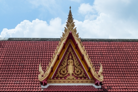 Buddha image at roof gable Stock Photo