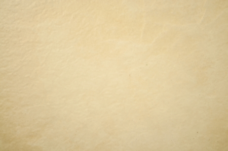 The beige color and rough texture ceramic tile background