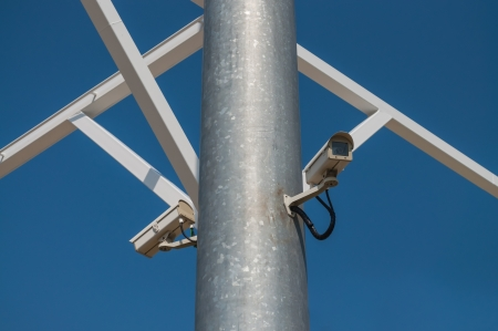 The CCTV camera on blue sky background