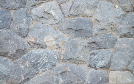 The pattern of granite rock wall  Stock Photo