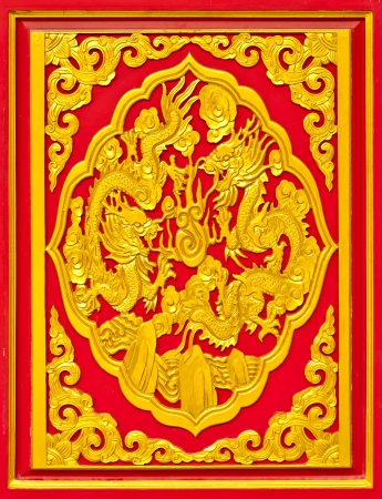 Chinese golden wood dragon sculpture on red background  photo