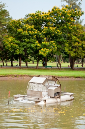 aerator: An aerator machine under operating in a park  Stock Photo