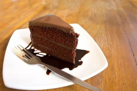 A piece of  chocolate cake with chocolate sauce  Stock Photo
