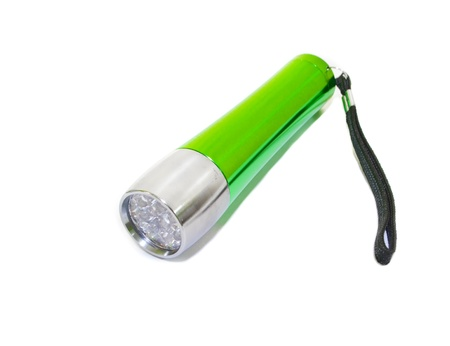 A green LED flashlight isolated on white background photo