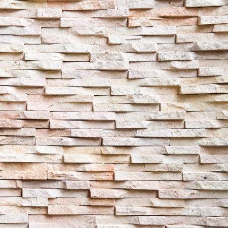 The pattern of sand stone tile wall background. Stock Photo
