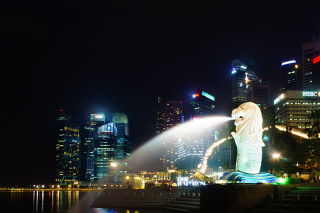 marina bay: SINGAPORE - AUG 24: Night View of skyscrapers in Marina Bay on August 24, 2014 in Singapore. Marina Bay is the most attractive landmark for tourism at Singapore. Editorial