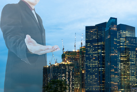Double exposure of business man and cityscape as background