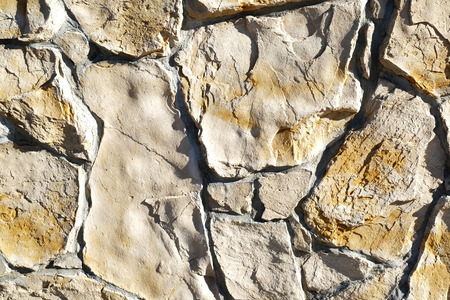 overbuilding: stone wall background Stock Photo