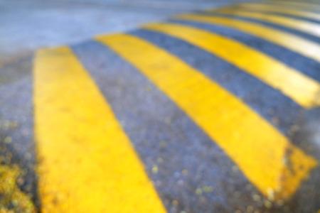washboard: Washboard road, yellow caution blur background