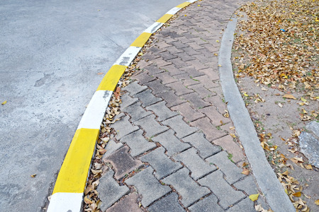 pavement: footpath pavement sidewalk with traffic sign