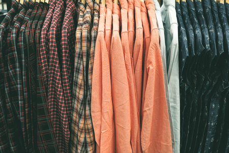 hangers: A row of jean clothes hanging on the rack