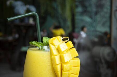 Refreshing mango smoothie in a glass, mango shake. tropical fruit concept